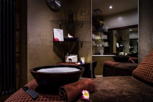 Spa bed with mirror and sink