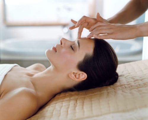 Lady receiving a facial massage