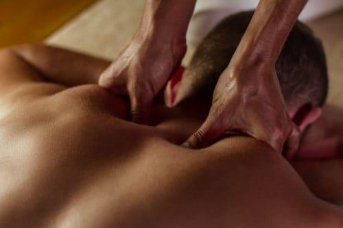 Man receving a deep tissue massage-min